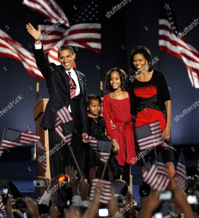President-elect Barack Obama with His Daughters Natasha (2nd L) and Malia (2nd R) and His Wife Michelle (r) Wave to the Crowd After He Delivered His Address at Grant Park in Chicago Illinois Usa to Celebrate His Victory On Election Day 04 November 2008 Obama Defeated Republican Presidential Candidate John Mccain to Become the 44th President of the United States and the First Black President in Us History