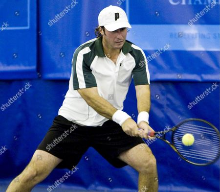 Vincent Spadea of the Usa Hits a Return Against Steve Darcis of Belgium During Their First Round Regions Morgan Keegan Championships Tennis Match at the Racquet Club of Memphis in Memphis Tennessee Usa 26 February 2008 Darcis Defeated Spadea 7-5 4-6 7-6(4)