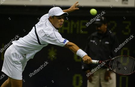 Korean Hyung-taik Lee Hits a Return Against American Jan-michael Gambill During First Round Action at the Sap Open at Hp Pavilion in San Jose California Monday 07 February 2005