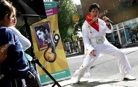 Elvis Impersonator Andy Woodward Performs in Downtown London England 16 August 2007 Woodward is Attempting to Set a New World Record to Perform Thirty Live Elvis Tribute Performances by One Person in One Day August 16 is the 30th Anniversary Since Elvis' Death