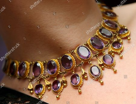 A Bonham's Staff Models a 20th Century Collar Necklace Composing of Oval Cut Amethysts Once Belonging to British Actress Deborah Kerr at Bonham's Auction House in London Britain 02 December 2008 the Stunning Necklace is Expected to Fetch 2 000 -2 500 Euros at Auction 04 December