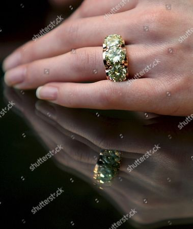 A Bonham's Staff Models an Engagement Ring Once Belonging to British Actress Deborah Kerr at Bonham's Auction House in London Britain 02 December 2008 the Diamond Three-stone Engagement Ring Dating Back to 1945 When She Married Squadron Leader Anthony Charles Bartley is Expected to Fetch 25 000 -30 000 Euros at Auction 04 December