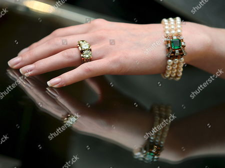 Stock Photo of A Bonham's Staff Models an Engagement Ring and Bracelet Once Belonging to British Actress Deborah Kerr at Bonham's Auction House in London Britain 02 December 2008 the Diamond Three-stone Engagement Ring Dating Back to 1945 When She Married Squadron Leader Anthony Charles Bartley is Expected to Fetch 25 000 -30 000 Euros at Auction 04 December the Cultured Pearl Emerald Diamond Bracelet is Expected to Fetch 5 000- 8 000 Euros