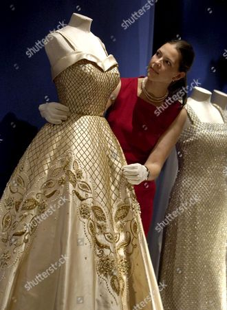 Curator Caroline De Guitaut Adjusts Part of an Evening Dress Designed by Norman Hartnell Worn by Britain's Queen Elizabeth Ii at a Display in Buckingham Palace in London Tuesday 25 July 2006 the Exhibition of Evening Dresses and Jewellery Forms Part of the Summer Opening of Buckingham Palace