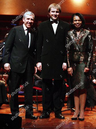 Us Secretary of State Condoleezza Rice (r) and British Foreign Secretary Jack Straw (l) Join Vasily Petrenko (c) Conductor of the Royal Philharmonic Orchestra On Stage at the Liverpool Philharmonic Hall On Friday 31 March 2006 Rice and Straw Were at the Philharmonic Hall in Liverpool to Watch a Performance by the Royal Liverpool Philharmonic Orchestra