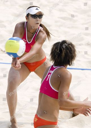 Chinese Pair Zhang Wen Wen (l) and Teammate Yue Yuan (r) During the Fivb Beach Volleyball Women's Challenge Match at Chaoyang Park Beach Volleyball Ground Stadium in Beijing China 17 Aug 2007 the Tournament is Part of a Series of Olympics Test Events Being Held in Beijing As the City Prepares For the Games in 2008 the Chinese Pair Won Their Quarterfinals Match and Will Face Schmoker and Forrer From Switzerland in the Semifinals