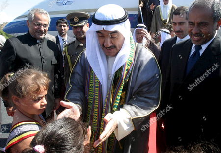 Kuwait's Prime Minister Sheikh Nasser Al-mohammed Al-ahmed Al-sabah (c) Accompanied by East Timor's President Jose Ramos Horta (l) and Prime Minister Estanislau Da Silva (r) is Greeted by East Timorese Young Girls As He Arrives at Komoro Airport in Dili East Timor 01 June 2007 Sheikh Nasser Mohammad Al-sabah is in an Official Visit to Tighten Bilateral Relationship Between Two Countries