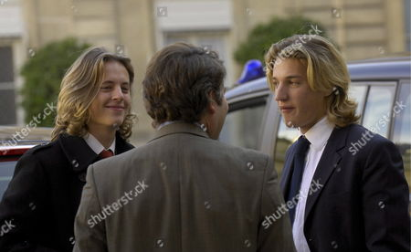 Jean Sarkozy (r) and Pierre Sarkozy (l) Sons of French President Nicolas Sarkozy Talk to the Director of Communications at Elysee Palace in Paris France 22 October 2007 Both Sons Are From Sarkozy's First Marriage