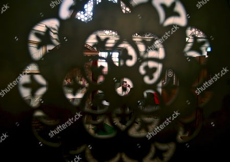 Stock Image of An Ultra-orthodox Jew (c) Seen Behind a Decorated Panel Praying Inside the Cave of the Patriarchs an Ancient Site Holy to to Both Jews and Moslems in the West Bank City of Hebron On 23 November 2008 to Jews the Cave Complex Contains the Burial Sites of Abraham Sarah Isaac Rebecca Jacob and Leah As Well As Adam and Eve to the Moslems It is the Burial Site of Ibrahim and Was Converted Into a Mosque in About the Year 1 200