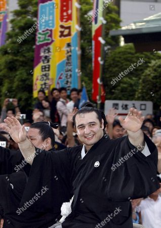 Accompanied by Sumo Wrestler Kotokasuga Bulgarian Ozeki Kotooshu (r) Waves From an Open Car During a Parade Outside the Kokugikan Sumo Arena in Tokyo Japan 25 May 2008 ?kotooshu Entered the Sumo History As He Became the First European Wrestler to Win the Emperor's Cup at a Grand Sumo Tournament
