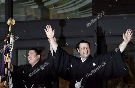 Accompanied by Sumo Wrestler Kotokasuga Bulgarian Ozeki Kotooshu (r) Waves From an Open Car at the Start of a Parade Outside the Kokugikan Sumo Arena in Tokyo Japan 25 May 2008 Kotooshu Entered the Sumo History As He Became the First European Wrestler to Win the Emperor's Cup at a Grand Sumo Tournament