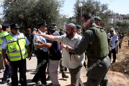 Editorial picture of Mideast Palestinians Israeli Settlers and Peace Activists - Oct 2008