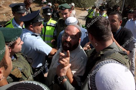 Stock Image of Israeli Police Officesr Try to Prevent an Israeli Jewish Settlers From Scuffling with Peace Activists During a Harvest of Olives Near the Kyriat Arba Jewish Settlement in the West Bank City of Hebron 03 October 2008 Israeli Settlers Clashed On 03 October at an Olive Grove Near Hebron with Activists Protesting the Israeli Occupation of the West Bank Police Said According to Settlers the Fracas Broke out When One of the Activists Pushed the Wife of Settler Leader Itamar Ben-gvir the Activists However Said the Settlers Attacked Them First One Anti-occupation Activist Was Detained by Police a Police Spokesman Chief Inspector Mickey Rosenfeld Said