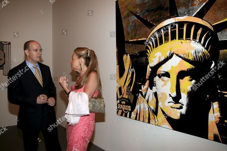 Prince Albert Ii (l) of Monaco is Guided by Lisa Dennison Next to a Andy Warhol Painting As He Inaugurates an Exhibition with the Thema : New York New York at the Grimaldi Forum in Monaco Thursday 13 July 2006