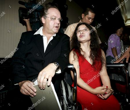 Stock Photo of Australian Lawyer Harry Freedman (l) with Filipino-australian Vivian Alvarez After Meeting the Press in Makati City Thursday 19 May 2005 Alvarez 42 Who Was Wrongfully Deported From Australia to the Philippines While Recovering From a Car Accident in 2001 is Expected to Return to Her Family in Australia where She Lived For Some 18 Years
