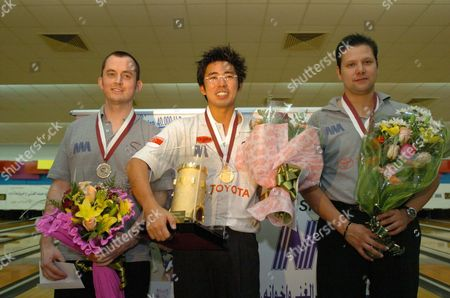 Mens Champion Singapore's Remy Ong (c) Posses with Runner Up Englands Nickfroggatt (l) and Third Place Winner Mario Quintero of Mexico After the Final Match at Qatar Bowling Center On Thursday 16 September 2004 More Than 140 Players From Different Parts of the World Participated in the Prestigious Tournament Total Prize Money Was Us $ 150 000