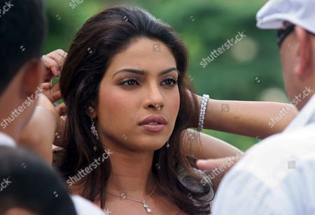 Indian Actress Priyanka Chopra (c) Prepares For Her Scene While Talking to Film Director Rakesh Roshan (r) at the Film Set of New Bollywood Movie 'Krrish' in Singapore On Thursday 15 September 2005 'Krrish' the Sequel to Bollywood Blockbuster 'Koi Mil Gaya' and Helmed by Roshan Will Be Filmed Mostly in Singapore in a Collaboration with the Singapore Tourism Board to Promote the Island-state