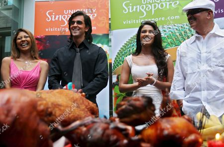 (l-r) Cast of New Bollywood Movie 'Krrish' Indian Actress Manini De Actor Hrithik Roshan and Actress Priyanka Chopra Along with Director Rakesh Roshan at a Traditional Taoist Ceremony Marking the Beginning the Filming For the Movie in Singapore On Thursday 15 September 2005 'Krrish' the Sequel to Bollywood Blockbuster 'Koi Mil Gaya' and Helmed by Roshan Will Be Filmed Mostly in Singapore in a Collaboration with the Singapore Tourism Board to Promote the Island-state