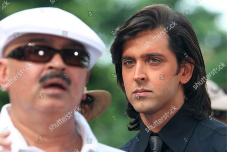 Indian Actor Hrithik Roshan (r) and Reknown Director Rakesh Roshan at the Film Set of New Bollywood Movie 'Krrish' in Singapore On Thursday 15 September 2005 'Krrish' the Sequel to Bollywood Blockbuster 'Koi Mil Gaya' and Helmed by Roshan Will Be Filmed Mostly in Singapore in a Collaboration with the Singapore Tourism Board to Promote the Island-state