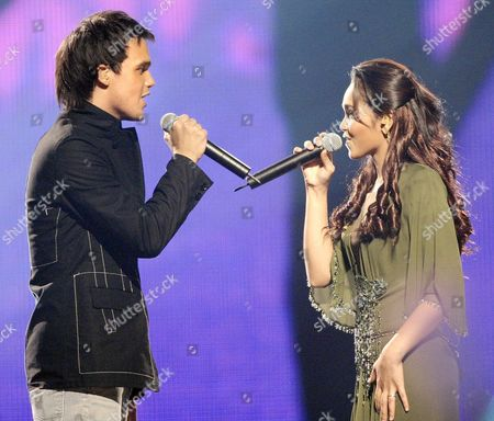 Stock Photo of British Singer Gareth Gates (l) Sings a Duet with Malaysia's Siti Nurhaliza at the Mtv Asia Awards in Singapore On Saturday 14 February 2004 Gates Won the Favourite Male Artist Award While Nurhaliza Took the Favourite Malaysian Artist Title