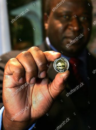 South African Reserve Bank Governor Tito Mboweni Smiles As He Holds a Newly-minted R5 Coin with Additional Security Features at the South African Mint in Pretoria South Africa Tuesday 27 July 2004 the New Coin Was Designed in a Bid to Outsmart Counterfeiters with Security Features Which Will Make It Easier For the South African Public to Distinguish Between Good Coins and Counterfeits the New Coin Which Comes Into Circulation Monday 02 August Consists of a Silver-coloured Border with a Bronze-coloured Centre Mboweni Also Unveiled a Special R2 Coin to Commemorate South Africa's 10 Years of Democracy Celebrations South African President Thabo Mbeki After Consultation with the Minister of Finance Decided Friday 23 July to Re-appoint Mboweni As Governor of the Bank For a Period of Five Years Ending Speculation of an Apparent Policy Diference with Finance Minister Trevor Manuel Over the Recent Strengthening of the Rand Against the Dollar the Rand is Currently at Its Strongest Rate Since 1999