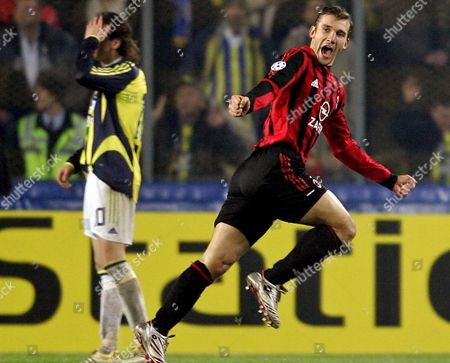 Ac Milan's Ukrainian Player Andriy Schevchenko (r) Celebrates His Second Goal As Fenerbahce's Tuncay Sanli (rear) Appears Dejected During Their Champions League Group E Match at Sukru Saracoglu Stadium in Istanbul Turkey On Wednesday; 23 November 2005