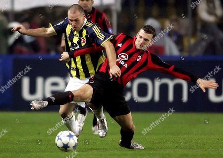 Ac Milan's Ukrainian Player Andriy Schevchenko (r) Challenges Fenerbahce's Serkan Balci (l) During Their Champions League Group E Match at Sukru Saracoglu Stadium in Istanbul Turkey On Wednesday 23 November 2005