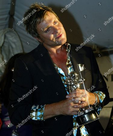 Simon Lebon of Duran Duran Poses For Photographers Backstage After Winning the Lifetime Achievement Award at the 2003 Mtv Video Music Awards at Radio City Music Hall in New York City Thursday 28 August 2003 Epa Photo/epa/jason Szenes// United States New York