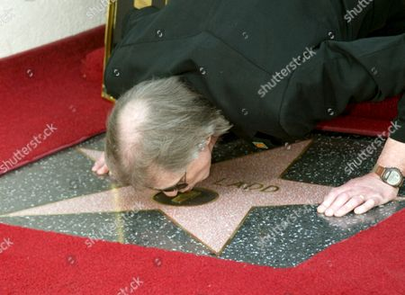 Us Radio Personality Jim Ladd Kisses His Star On the Hollywood Walk of Fame in Los Angeles Friday 06 May 2005