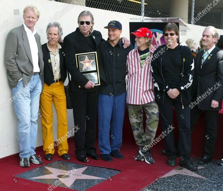 Friends Stand Next to Veteran Los Angeles Radio Personality Jim Ladd On His New Star On the Hollywood Walk of Fame Following Dedication Ceremonies Friday 06 May 2005 in a Career Spanning More Than 30 Years Ladd Has Established Himself As a Unique Personality with His Free-form Rock 'N' Roll Programming and 'Theater of the Mind ' Entertainment Greats Including Jackson Browne George Thorogood and Woody Harrelson Were Among Those Honouring Ladd