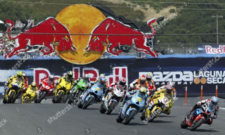 Kenny Roberts Jr (r) Takes the Lead at the Start of the Red Bull U S Grand Prix at Laguna Seca Raceway in Salinas California Sunday 23 July 2006 Nicky Hayden of the Us Won Dani Pedrosa of Spain Finished Second and Marco Melandri of Italy Finished Third