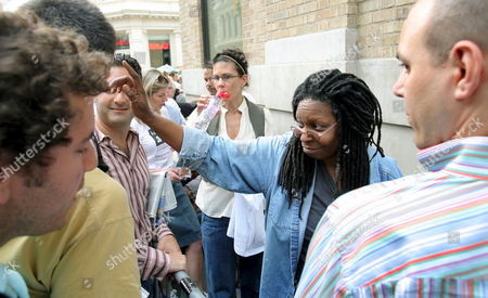 Comedian Whoopie Goldberg (c) Waves While Waiting in Line at the Soho Apple Store to Buy the New Apple Iphone in New York Usa On 29 June 2007 the Long Awaited Phone Ipod Camera Email Device is Being Released Today and Many People Waited in Long Lines to Make the Purchase