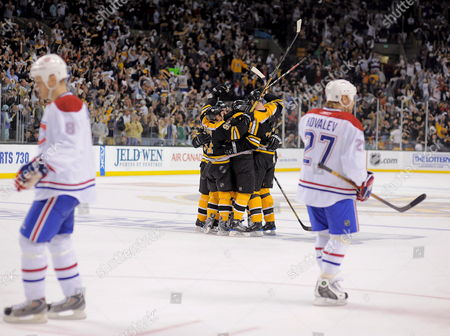 The Boston Bruins (c) Celebrate the Third Period Goal by Boston Bruins' Milan Lucic As Montreal Canadiens Defenseman Mike Komisarek(l) and Montreal Canadiens Right Wing Alexei Kovalev of Russia (r) Skate During the 5-4 Win by the Boston Bruins of the Eastern Conference Quarterfinal Playoff Game at the Td Bank North Garden in Boston Massachusetts 19 April 2008 the Best of Seven Series is Tied at Three Games Apiece