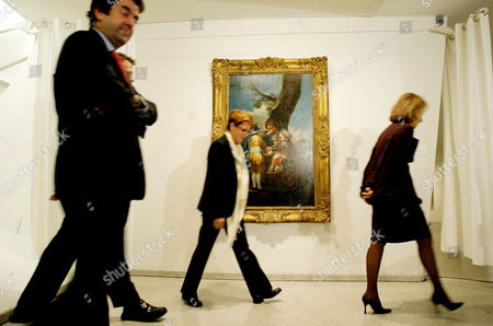 Stock Image of From Left Carlos Alberdi Alonso Director General of the Spanish Ministry of Culture Carmen Gimenez a Curator at the Guggenheim Museum and Lisa Dennison the Director of the Guggenheim Museum Walk Past the Recently Recovered Francisco De Goya Y Lucientes Painting 'Children with a Cart' at the Solomon R Guggenheim Museum in New York New York On Thursday 15 February 2007 the Painting Was Stolen in November 2006 While On Route to New York City For the Opening of the Spanish Painting Exhibit the Painting Was Recovered by the Federal Bureau of Investigation and Returned to the Toledo Museaum of Art On 11 January 2007