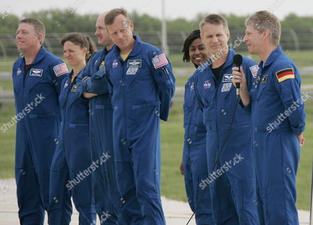 The Sts-121 Nasa Flight Crew Stands at Launch Pad 39b For Questions From the Media As Part of the Terminal Countdown Demonstration Tests (tcdt) at Kennedy Space Center (ksc) Cape Canaveral Florida Wednesday 14 June 2006 the Tcdt is a Launch Dress Rehearsal That Occurs Prior to Each Shuttle Mission (l-r) Astronaut Pilot Mark E Kelly Looks Past Commander Steve W Lindsey Mission Specialists Stephanie D Wilson and Piers J Sellers As European Space Agency (esa) Astronaut Thomas Reiter of Germany Answers Questions From the Media