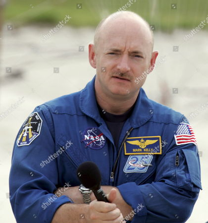 Astronaut Pilot Mark E Kelly From the Sts-121 Nasa Flight Crew Stands at Launch Pad 39b and Answers Questions From the Media As Part of the Terminal Countdown Demonstration Tests (tcdt) at Kennedy Space Center (ksc) Cape Canaveral Florida Wednesday 14 June 2006 the Tcdt is a Launch Dress Rehearsal That Occurs Prior to Each Shuttle Mission
