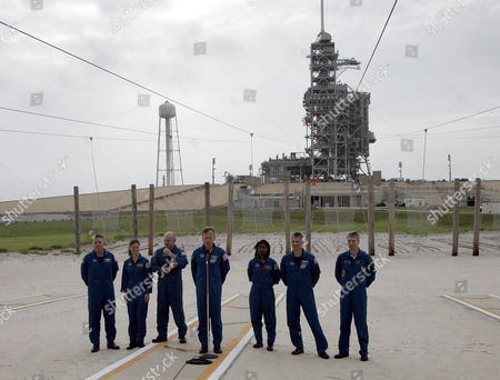 The Sts-121 Nasa Flight Crew Arrives at Launch Pad 39b For Questions From the Media As Part of the Terminal Countdown Demonstration Tests (tcdt) at Kennedy Space Center (ksc) Cape Canaveral Florida Wednesday 14 June 2006 the Tcdt is a Launch Dress Rehearsal That Occurs Prior to Each Shuttle Mission (l-r) Astronaut Mission Specialists Michael E Fossum Lisa M Nowak Pilot Mark E Kelly Commander Steve W Lindsey Mission Specialists Stephanie D Wilson Piers J Sellers and European Space Agency (esa) Astronaut Thomas Reiter of Germany in the Escape Area of Pad 39b Waiting to Answer Questions From the Media
