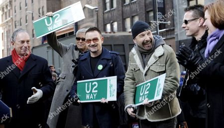 Members of the Band U2 Adam Clayton (2nd L) Bono (3rd L) the Edge (2nd R) and Larry Mullen Jr (r) Stand with New York City Mayor Michael Bloomberg (l) and New York City Council Speaker Christine C Quinn (r) After Unveiling a Street Sign For 'U2 Way' in New York New York Usa On 03 March 2009 Mayor Michael Bloomberg Temporarily Renamed West 53rd Street Today in Honor of the Band's New Album Which is Being Released This Week