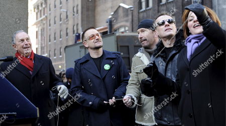 Members of the Band U2 Bono (2nd L) the Edge (3rd L) and Larry Mullen Jr (2nd R) Stand with New York City Mayor Michael Bloomberg (l) and New York City Council Speaker Christine C Quinn (r) As They Prepare to Unveil a Street Sign For 'U2 Way' in New York New York Usa On 03 March 2009 Mayor Michael Bloomberg Temporarily Renamed West 53rd Street Today in Honour of the Band's New Album Which is Being Released This Week