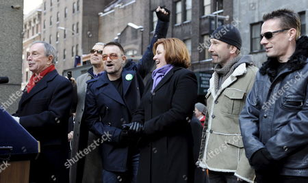 Members of the Band U2 Adam Clayton (2nd L) Bono (3rd L) the Edge (2nd R) and Larry Mullen Jr (r) Stand with New York City Mayor Michael Bloomberg (l) and New York City Council Speaker Christine C Quinn (2nd R) As They Prepare to Unveil a Street Sign For 'U2 Way' in New York New York Usa On 03 March 2009 Mayor Michael Bloomberg Temporarily Renamed West 53rd Street Today in Honor of the Band's New Album Which is Being Released This Week