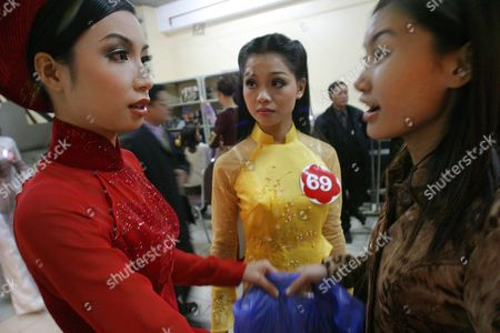 Women in the Miss Universe-hanoi Beauty Pageant Prepare Backstage Before Competing at the Melia Hotel Ballroom in Hanoi On Saturday 20 December 2003 Amelia Vega From the Domincan Republic Miss Universe 2003 Was On Hand to Crown the Winner of the Contest Who Would Go On to Represent Vietnam in Miss Universe 2004