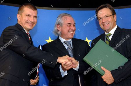 Stock Picture of (l to R) Home Affairs Ministers of Slovenia Dragutin Mate Hongria Albert Takacs and Austria Gunther Platter Shake Hands After Signing an Agreement On the Dolga Vas Cooperation Center For Security Authorities Ahead to the European Justice Interior Affairs (jai) Council in Brussels Belgium 08 November 2007
