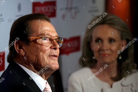 British Actor Roger Moore (l) Speaks to the Press As His Wife Christina Tholstrup Looks On During a Press Conference to Promote His New Book 'My Word is My Bond' in Hong Kong China 27 November 2008