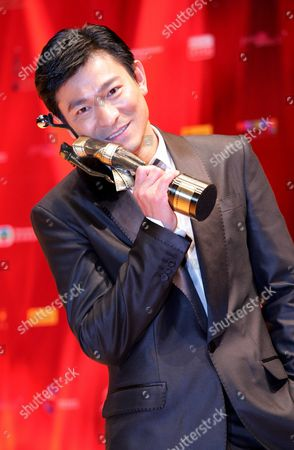 Hong Kong Actor Andy Lau Tak Wah Holds His Award After Being Honoured 'Best Supporting Actor' For the Movie 'Protege' at the 27th Hong Kong Film Awards in Hong Kong China 13 April 2008