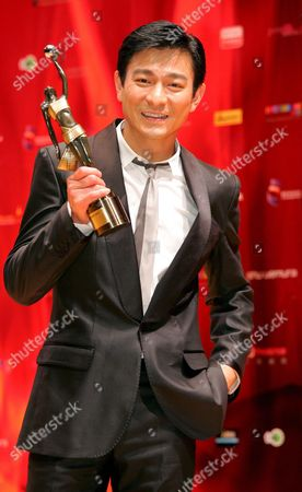 Stock Picture of Hong Kong Actor Andy Lau Tak Wah Holds His Award After Being Honoured 'Best Supporting Actor' For the Movie 'Protege' at the 27th Hong Kong Film Awards in Hong Kong China 13 April 2008