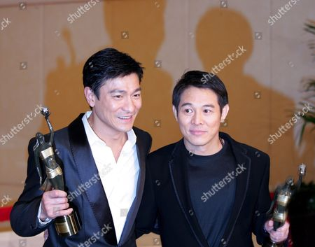 Stock Photo of Hong Kong Actor Andy Lau Tak Wah (l) and Chinese Actor Jet Li Hold Their Award After Lai Being Honoured 'Best Supporting Actor' For His Role in the Movie 'Protege' and Li Being Honoured 'Best Actor' For His Performance in the Movie 'The Warlords' at the 27th Hong Kong Film Awards in Hong Kong China 13 April 2008