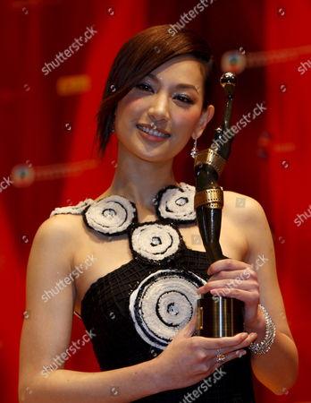 Stock Image of Hong Kong Actress Kate Tsui Holds Her Award After Being Honoured 'Best New Performer' at the 27th Hong Kong Film Awards in Hong Kong China 13 April 2008