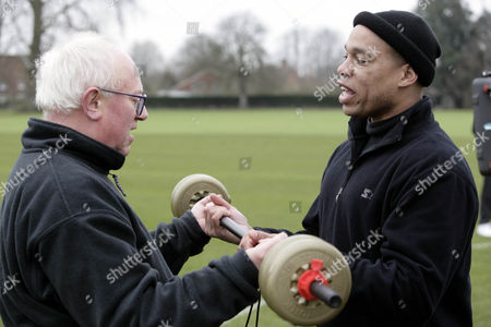 'Celebrity Fit Club' TV - 2005 - Ken Morley being shown how to do the dumb bell exercise by Harvey Walden.