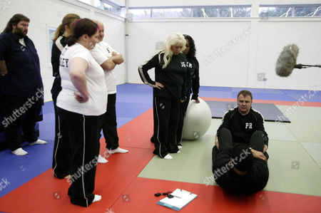 'Celebrity Fit Club' TV - 2005 - Trainer Harvey Walden showing the celebs how to do sit-ups.