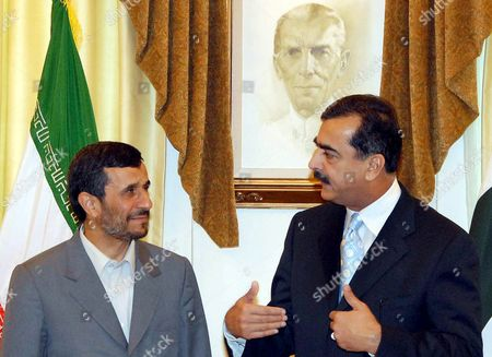 Stock Image of Iran's President Mahmoud Ahmadinejad (l) Talks with Pakistani Prime Minister Syed Yousaf Raza Gillani (r) During Their Meeting at the Prime Minister's Office in Islamabad Pakistan 28 April 2008 During His Four-hour Visit Ahmadinejad is to Meet with President Pervez Musharraf and to Sign a Landmark Agreement On a 4 8 Billion Euro Iran-pakistan-india (ipi) Gas Pipeline Project the Picture On the Wall Shows Father of the Pakistani Nation Mohammad Ali Jinnah